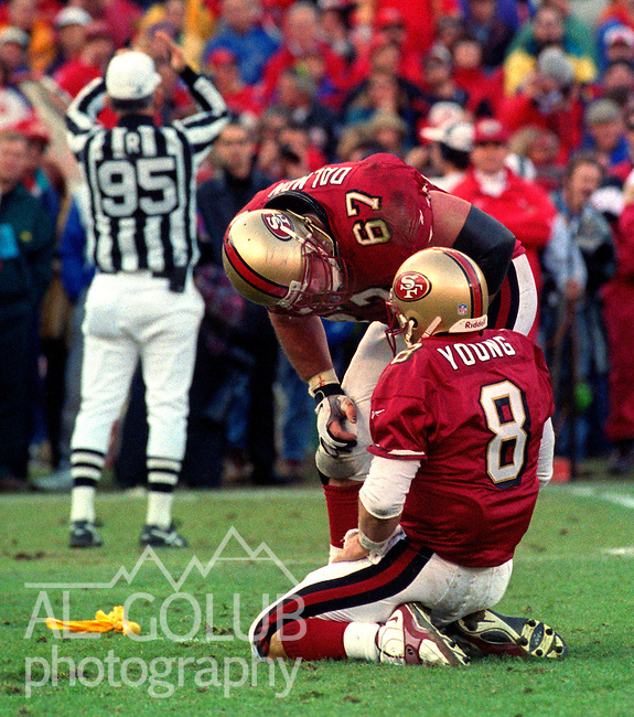 San Francisco 49ers vs. Minnesota Vikings at Candlestick Park Saturday, January 3, 1998.  49ers beat Vikings  38-22.  San Francisco 49ers quarterback Steve Young (8) is check by center  Chris Dalman (67) .