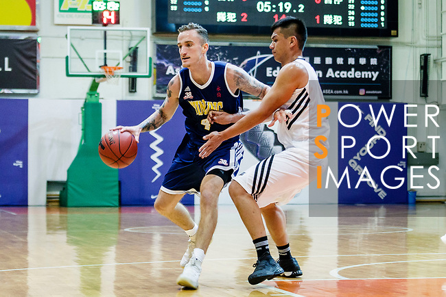 Bullen Christian Matthew #4 of Winling Basketball Club (L) dribbles the ball up court against Eagle during the Hong Kong Basketball League game between Eagle and Winling at Southorn Stadium on May 4, 2018 in Hong Kong. Photo by Yu Chun Christopher Wong / Power Sport Images