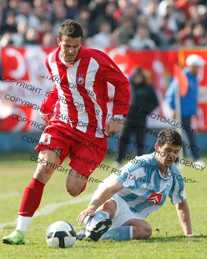 Fudbal, Jelen super liga, season 2008/09.OFK Beograd Vs. Crvena Zvezda.Mirnez Sisic, left and Zoran Milovac.Beograd, 14.03.2009..Photo: © Srdjan Stevanovic/Starsportphoto.com