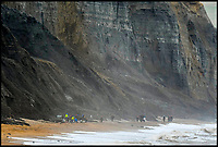 BNPS.co.uk (01202 558833)<br /> Pic: Graham Hunt/BNPS<br /> <br /> Filming at the fossil laden cliffs at Charmouth this afternoon.<br /> <br /> Film crew and actors on the Beach at Charmouth in Dorset today for the filming of the new film Ammonite about the life of fossil hunter Mary Anning starring Kate Winslet and Saoirse Ronan.<br /> <br /> Kate Winslet taking a ride in an off road buggy to her next filming location.