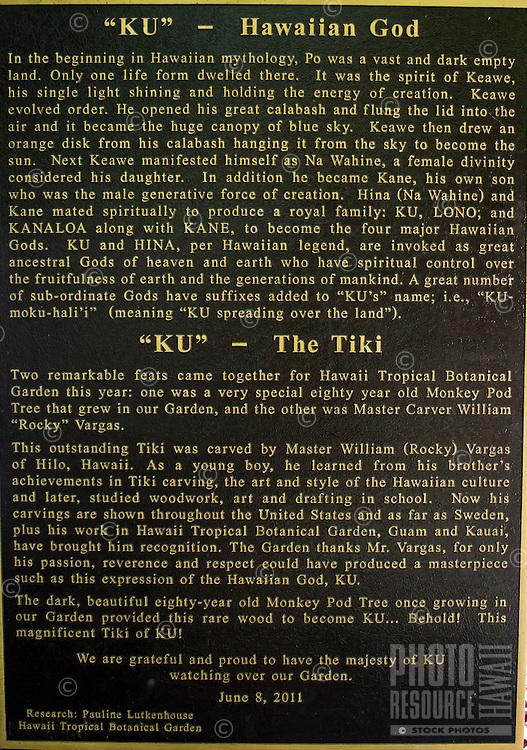 "A sign with information about the carved wooden tiki (or ki'i in Hawaiian) of the Hawaiian god ""KU"" at the Hawaii Tropical Botanical Garden, Papa'ikou (north of Hilo), Big Island of Hawaiʻi."