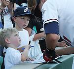 Aces Yunesky Sanchez signs autographs for young fans.  Photo by Tom Smedes.