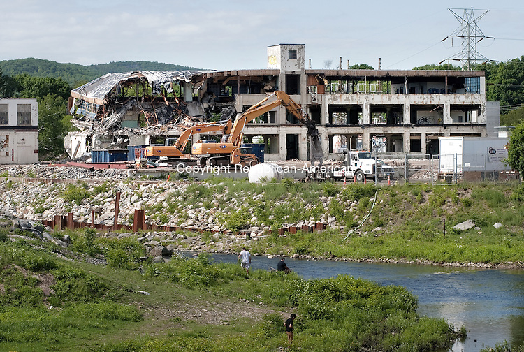 TORRINGTON, CT, 03  JUNE 15 - The demolition of the Nidec factory on Franklin Drive in Torrington is nearing completion as workers have reached the core section of the building that once spanned more than 100,000 square feet along the riverfront. Alec Johnson/ Republican-American