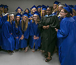 McQueen graduates pose with Washoe County School District Superintendent Traci Davis before the McQueen High School Graduation on Saturday, June 10, 2017 at Lawlor Events Center in Reno.