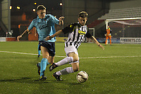 Lewis McLear turns away from Ross Drummond in the St Mirren v Dunfermline Athletic Scottish Professional Football League Under 20 match played at the Excelsior Stadium, Airdrie on 11.12.13.