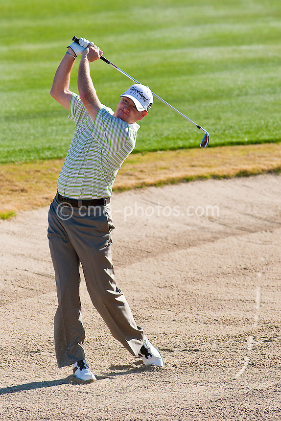Feb 1, 2009; Scottsdale, AZ, USA; Steve Flesch (USA) hits out of a fariway bunker on the 3rd hole during the final round of the FBR Open at the TPC Scottsdale.  Mandatory Credit: Chris Morrison-US PRESSWIRE