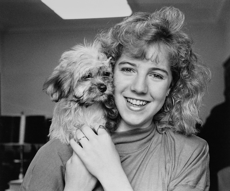 Rep. John Glen Browder's daughter Jenny Rebecca Browder with new Shih Tzu puppy. June 1989 (Photo by Laura Patterson/CQ Roll Call)
