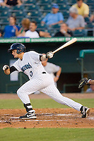 Daniel Pertusati #12 of the Jupiter Hammerheads follows through on his swing against the Charlotte Stone Crabs at Roger Dean Stadium June 15, 2010, in Jupiter, Florida.  Photo by Brian Westerholt /  Seam Images