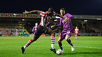 Lincoln City's John Akinde vies for possession with Carlisle United's Richard Bennett<br /> <br /> Photographer Chris Vaughan/CameraSport<br /> <br /> The Emirates FA Cup Second Round - Lincoln City v Carlisle United - Saturday 1st December 2018 - Sincil Bank - Lincoln<br />  <br /> World Copyright © 2018 CameraSport. All rights reserved. 43 Linden Ave. Countesthorpe. Leicester. England. LE8 5PG - Tel: +44 (0) 116 277 4147 - admin@camerasport.com - www.camerasport.com