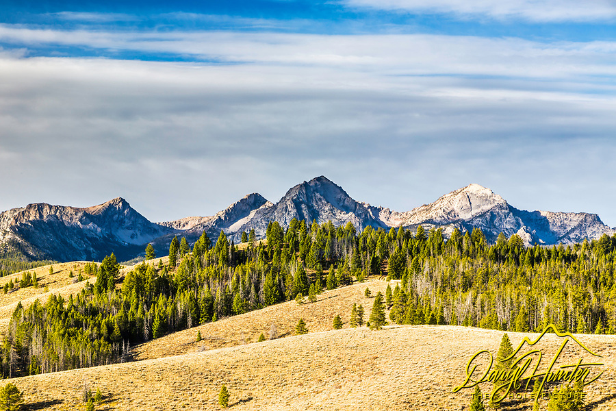 The rolling sagebrush and lodgepole pine covered hills of Stanley Idaho beneath the stunning Sawtooth Mountain Range of Central Idaho.