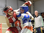 John Lawrence (in red) from Holy Family in action in the Louth Meath Boxing Championships held in Holy Family Boxing Club Ballsgrove.  Photo:Colin Bell/pressphotos.ie