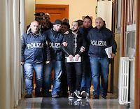 Italian police officers lead Camorra Mafia boss  Mario Riccio,  of Scampia <br /> Naples<br />  Mario Riccio boss di del clan pagano Amato di Scampia  scortato dagli agenti di polizia dopo il suo arresto<br /> <br /> Italian police officiers lead  Camorra mafia boss  Mario Riccio, <br /> Riccio is the youngest fugitive   on the Italian Interior Ministry's list of the 100 most dangerous fugitives still in circulation