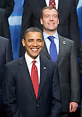 United States President Barack Obama, front, and Dmitry Medvedev, Russia's president, pose for a group photo with the heads of delegations attending the Nuclear Security Summit at the Washington Convention Center in Washington, D.C., U.S., on Tuesday, April 13, 2010. Ukraine's agreement to relinquish its entire stockpile of highly enriched uranium gave Obama the first concrete result for a summit he convened on securing the world's atomic material. .Credit: Andrew Harrer / Pool via CNP