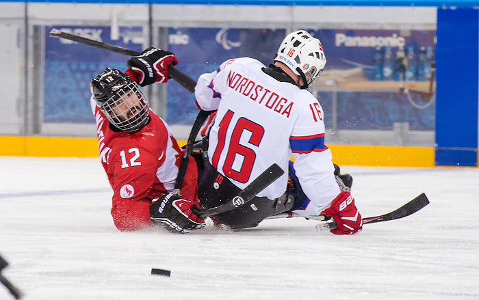 Sochi, RUSSIA - Mar 15 2014 - Greg Westlake as Canada takes on Norway in the Bronze Medal Sledge Hockey game  at the 2014 Paralympic Winter Games in Sochi, Russia.  (Photo: Matthew Murnaghan/Canadian Paralympic Committee)