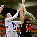 February 28, 2020; Yankton at St. Thomas More High School Basketball -- Mairin Duffy #33 of St. Thomas More readies a shot over Yankton defender Sadie Fedders #14 during their game Friday evening at Barnett Arena in Rapid City, S.D.(Photo by Richard Carlson/Inertia)