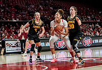 COLLEGE PARK, MD - FEBRUARY 13: Shakira Austin #1 of Maryland goes in for a shot in front of Kate Martin #20 of Iowa during a game between Iowa and Maryland at Xfinity Center on February 13, 2020 in College Park, Maryland.