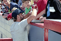Boston Red Sox Mike Greenwell signs autographs during spring training circa 1990 at Chain of Lakes Park in Winter Haven, Florida.  (MJA/Four Seam Images)