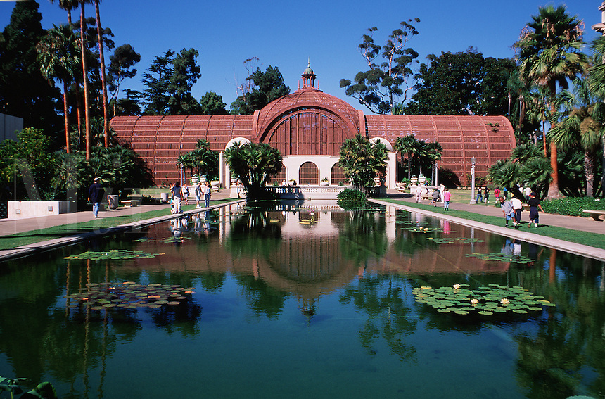 A botanical building reflecting in the pool of water in Balboa Park. San Diego, California.