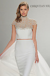 Model walks runway in an embroidered collar and strapless cropped dress with train from the Christian Siriano for Kleinfeld bridal collection, at Kleinfeld on April 18, 2016 during New York Bridal Fashion Week Spring Summer 2017.