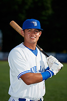 Bluefield Blue Jays Hector Guerrero (15) poses for a photo before a game against the Bristol Pirates on July 26, 2018 at Bowen Field in Bluefield, Virginia.  Bristol defeated Bluefield 7-6.  (Mike Janes/Four Seam Images)