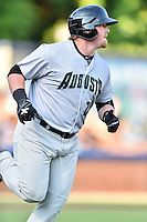 Augusta GreenJackets designated hitter Skyler Ewing (25) runs to first base during a game against the Asheville Tourists at McCormick Field on August 5, 2016 in Asheville, North Carolina. The Tourists defeated the GreenJackets 7-6. (Tony Farlow/Four Seam Images)