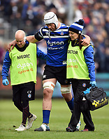 Dave Attwood of Bath Rugby is helped off the field by Cerian Parham and Dr. Jo Larkin. Gallagher Premiership match, between Bath Rugby and Wasps on May 5, 2019 at the Recreation Ground in Bath, England. Photo by: Patrick Khachfe / Onside Images