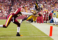 After catching a pass, Steelers WR Santonio Holmes (10) dives over the goal line past Redskins CB Carlos Rogers (22) for a TD during the fourth quarter.  The Pittsburgh Steelers defeated the Washington Redskins 23-6 on Monday Night Football at FedEx Field in Landover, MD.
