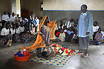 ARUA , UGANDA, JULY 9, 2006 :  Members of Nacwola speake and perfrom a play after church service in a catholic church outside Arua to inform the community about living with HIV, prevention, treatment and acceptance in Arua, Uganda on July 9, 2006. Nacwola is a woman PHA group (people living with HIV-AIDS) and most members are widows on ARV treatment. Rose Atibuni (speaking) is the chairwoman of the group in Arua, and the only survivor of the 4 founding members. Their aim is to support hiv positive people, inform the community about HIV and fight stigma by performing plays and songs. The ARV treatment program started July 2002 at the HIV clinic run by MSF in Arua hospital. (Photo by Jean-Marc Giboux)
