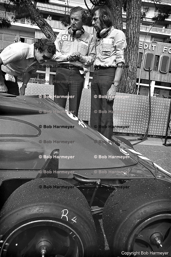 Derek Gardner (center), designer of the Tyrrell P34 six-wheel Formula 1 car, in the pit lane during practice for the 1976 Grand Prix of Monaco.