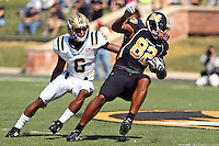 MU tight end Martin Rucker attempts to elude Western Michigan Broncos corner back Londen Fryar during the first half at Memorial Stadium in Columbia, Missouri on September 15, 2007. The Tigers won 52-24.