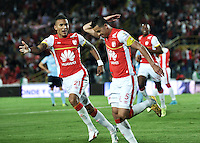 BOGOTA - COLOMBIA - 03-10-2015: Yulian Anchico (Der.) y Francisco Meza (Izq.), jugadores de Independiente Santa Fe celebran el gol anotado al Atletico Junior, durante partido por la fecha 15 entre Independiente Santa Fe y Atletico Junior, de la Liga Aguila II-2015, en el estadio Nemesio Camacho El Campin de la ciudad de Bogota. / Yulian Anchico (R) and Francisco Meza (L)  players of Independiente Santa Fe, celebrate a scored goal to Atletico Junior, during a match of the 15 date between Independiente Santa Fe and Atletico Junior, for the Liga Aguila II -2015 at the Nemesio Camacho El Campin Stadium in Bogota city, Photo: VizzorImage / Luis Ramirez / Staff.
