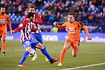 Atletico de Madrid's Juanfran Torres and Antoine Griezmann and SD Eibar's Ruben Peña Jimenez during Copa del Rey match between Atletico de Madrid and SD Eibar at Vicente Calderon Stadium in Madrid, Spain. January 19, 2017. (ALTERPHOTOS/BorjaB.Hojas)