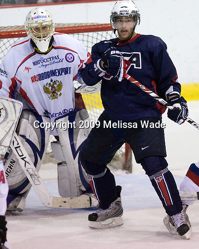 Dmitry Shikin (Russia - 20), Jerry D'Amigo (US - 9) - Team USA defeated Team Russia 6-1 in their second game during the 2009 USA Hockey National Junior Evaluation Camp on Wednesday, August 12, 2009, in the USA (NHL-sized) Rink in Lake Placid, New York.