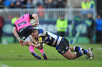 Anthony Perenise tackles Owen Jenkins to ground. LV= Cup match, between Bath Rugby and Cardiff Blues on January 25, 2014 at the Recreation Ground in Bath, England. Photo by: Patrick Khachfe / Onside Images