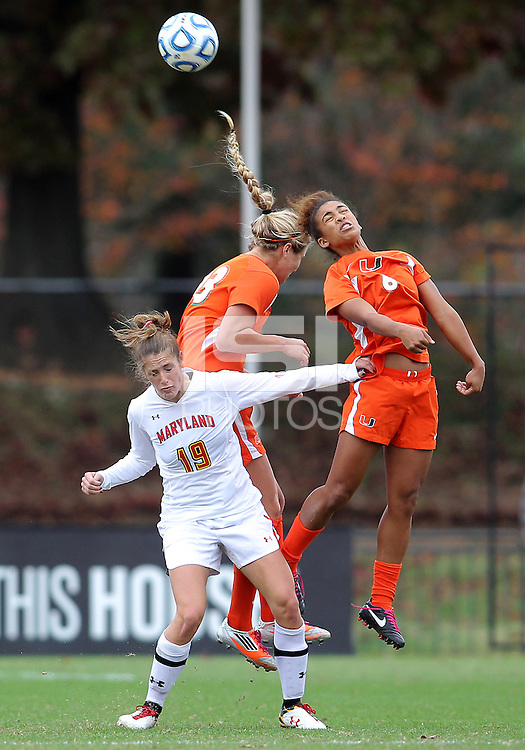 COLLEGE PARK, MD - OCTOBER 28, 2012:  Becky Kaplan (19) of the University of Maryland can't get up for a header against Jordan Roseboro (6) of Miami during an ACC  women's tournament 1st. round match at Ludwig Field in College Park, MD. on October 28. Maryland won 2-1 on a golden goal in extra time.