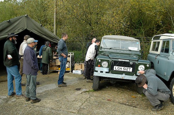 Dunsfold Landrovers Series 1 Parts Weekend 22-24/10/2004, Dunsfold, UK. Customers inspecting an extremely rare Land Rover 100 inch 4 door swiss-army-prototype. --- No releases available. Automotive trademarks are the property of the trademark holder, authorization may be needed for some uses. --- The garage Dunsfold Landrovers (DLR) was established in 1968 in Dunsfold, Surrey, UK. Due to the ever growing number of Land Rover vehicles the Dunsfold Collection of Land Rovers was launched in 1993. Supported by the company Land Rover and the Gaydon Heritage Centre today Dunsfold is maintaining the biggest and most varied collection of Land Rovers in the world. Because of the enormous quantity of original spare parts for older Land Rovers that are now stored in Dunsfold, every now and then a theme-event is held.