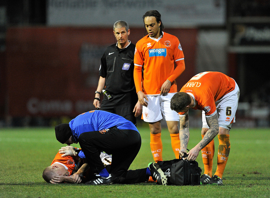 Blackpool's Jamie O'Hara went off injured in the first half<br /> <br /> Photographer Ashley Western/CameraSport<br /> <br /> Football - The Football League Sky Bet League One - Brentford v Blackpool - Tuesday 24th February 2015 - Griffin Park - London<br /> <br /> &copy; CameraSport - 43 Linden Ave. Countesthorpe. Leicester. England. LE8 5PG - Tel: +44 (0) 116 277 4147 - admin@camerasport.com - www.camerasport.com