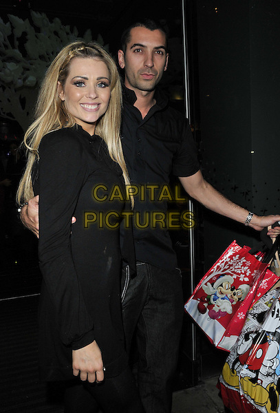 Nicola McLean & Tommy Williams.The Disney Store VIP party, the Disney Store, Oxford St., London, England, Wed/02nd/Nov/2011..November 2nd, 2011.half length couple tom side bags dress black.CAP/CAN.©Can Nguyen/Capital Pictures.