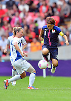 August 06, 2012..Japan's Aya Miyama #8 and France's Marie-Laure Delie #11 during Semi Final match at the Wembley Stadium on day ten in Wembley, England. Japan defeats France 2-1 to reach Women's Finals of the 2012 London Olympics.