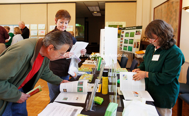 Roxbury, CT-10, April 2010-041010CM06  Frank Masi (left) and his wife Cathy, of Roxbury talk with Donna Culbert, the Newtown Health District Director about tick prevention, Saturday afternoon at the Roxbury Town Hall.  Culbert was apart of the Freedom Lawn Expo, which was open to the public.  The event had several booths with experts providing information regarding a naturalistic approach to lawn care, promoting unrestricted growth and discouraging the use of lawn fertilizers.  Culbert was promoting the BLAST approach for tick prevention.  BLAST is an acronym for Bathe after being outdoors, Look for ticks, Apply repellents, Spray the perimeter of your yard, and Tret pets with tick products. --Christopher Massa Republican-American