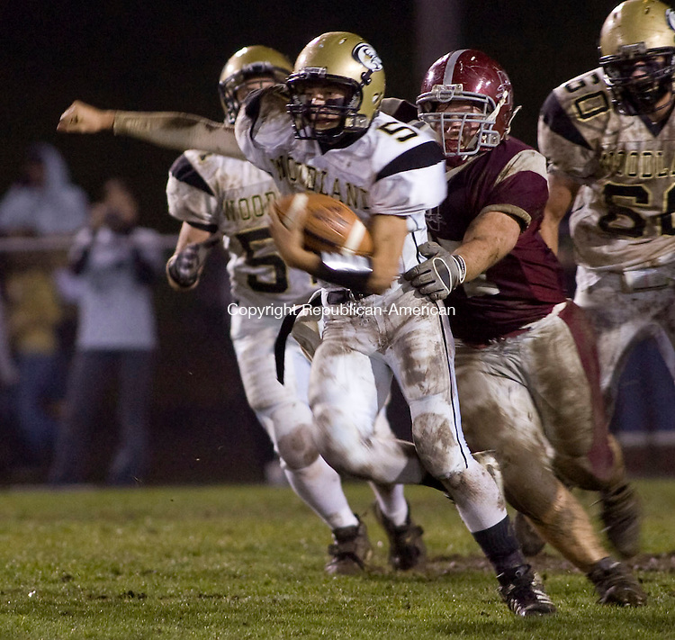 NAUGATUCK, CT - 07 NOVEMBER 2008 -110708JT02--<br /> Woodland's Brandon Fowler escapes being tackled by Naugatuck's Dan Mariano during Friday's game at Naugatuck. Woodland won.<br /> Josalee Thrift / Republican-American