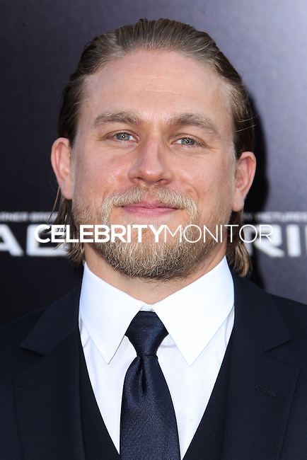 """[(FILE) Actor Charlie Hunnam has dropped out of the lead role of character Christian Grey in the """"Fifty Shades of Grey"""" (2014) film adaptation. """"The filmmakers of 'Fifty Shades of Grey' and Charlie Hunnam have agreed to find another male lead given Hunnam's immersive TV schedule which is not allowing him time to adequately prepare for the role of Christian Grey,"""" Universal Pictures said in a statement, obtained by The Hollywood Reporter.] HOLLYWOOD, CA - JULY 09: Actor Charlie Hunnam attends the premiere of Warner Bros. Pictures and Legendary Pictures' 'Pacific Rim' at the Dolby Theatre on July 9, 2013 in Hollywood, California. (Photo by Xavier Collin/Celebrity Monitor)"""