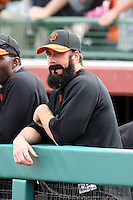 Brian Wilson #38 of the San Francisco Giants watches his teammates play against the Arizona Diamondbacks in the first spring training game of the season at Scottsdale Stadium on February 25, 2011  in Scottsdale, Arizona. .Photo by:  Bill Mitchell/Four Seam Images.