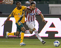 LA Galaxy Fwd Evans Wise battles for the ball versus Necaxa Def Edgar Zapata. Necaxa defeated LA Galaxy 1-0 in an International friendly match at The Home Depot Center in Carson, California, Wednesday July 12, 2006.