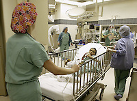 Derick Byrd is wheeled into the operating room for his surgery at Children's Hospital, Friday June 17, 2005, in Columbus, Ohio. Derick's surgery was a non-invasive procedure using an electromagnetic field to create heat that softens a polymer, allowing Derick's plastic and titanium prosthesis to expand.<br />