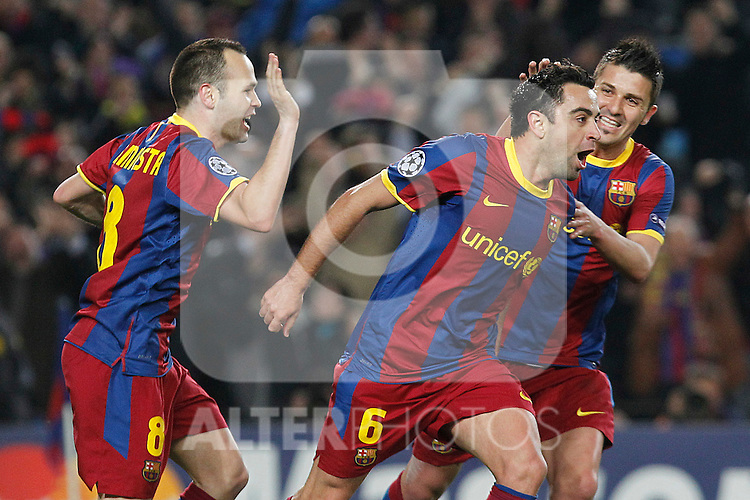 FC Barcelona's Xavi Hernandez (c), Andres Iniesta and David Villa celebrate goal during UEFA Champions League match.March 8,2011. (ALTERPHOTOS/Acero)
