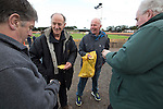 Two men selling prize draw tickets to spectators inside Shielfield Park, before the Scottish League Two fixture between Berwick Rangers and East Stirlingshire. The home club occupied a unique position in Scottish football as they are based in Berwick-upon-Tweed, which lies a few miles inside England. Berwick won the match by 5-0, watched by a crowd of 509.