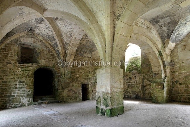 Forge, Fontenay Abbey, Marmagne, Cote d'Or, France. This Cistercian abbey was founded by Saint Bernard of Clairvaux in 1119, built in the Romanesque style. The abbey itself housed 300 monks from 1200, but was sacked during the French Revolution. The 53m water-powered forge is the oldest metallurgical factory in Europe, dating from 1220. It was recently reconstructed. The monks extracted iron ore from a nearby hill and forged iron tools to sell. The Cistercians were masters of metallurgy and invented the hydraulic hammer on this site. This is one of the four rooms in the forge and has a Roman arch and a Gothic arch. Picture by Manuel Cohen