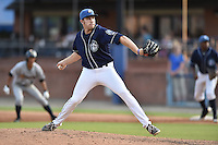 Asheville Tourists pitcher Troy Neiman #23 delivers a pitch during a game against the Charleston RiverDogs at McCormick Field July 26, 2014 in Asheville, North Carolina. The RiverDogs defeated the Tourists 8-7. (Tony Farlow/Four Seam Images)