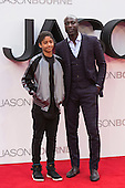 London, UK. 11 July 2016. Fashion designer Ozwald Boateng OBE with son Oscar Boateng. Red carpet arrivals for the European Premiere of the Universal movie Jason Bourne (2016) in London's Leicester Square.